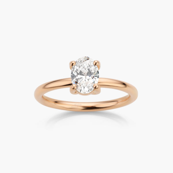 Rose gold ring ((1848)) set with on oval shaped diamond