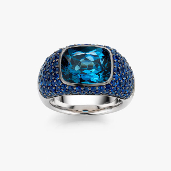Solis ring in white gold set with blue topaz and blue sapphires