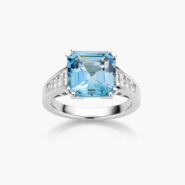 White gold ring ((Artsy)) set with a radiant shaped aqua-marine and baguette shaped diamonds