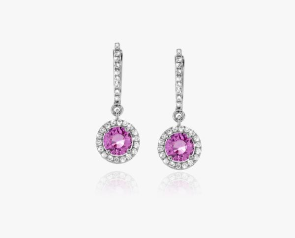 White gold earrings, set with a pink oval-cut sapphire and framed by diamonds