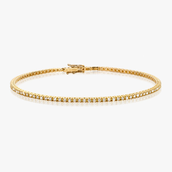 Yellow gold bracelet set with brilliants