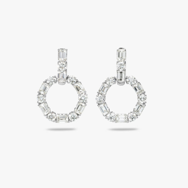 White gold earrings set with emerald shaped diamonds and brilliants