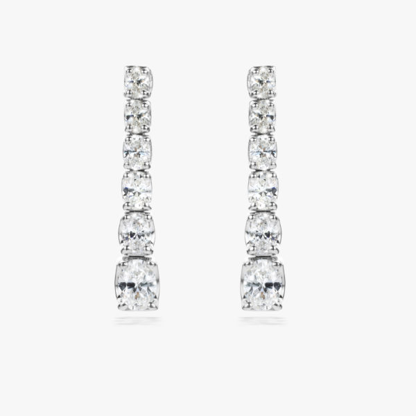 White gold earrings set with oval shaped diamonds