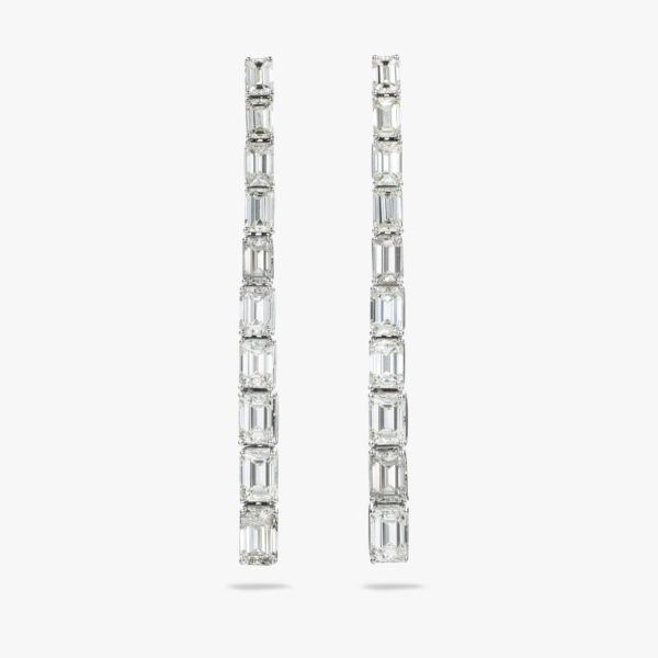 White gold earrings set with emerald shaped diamonds
