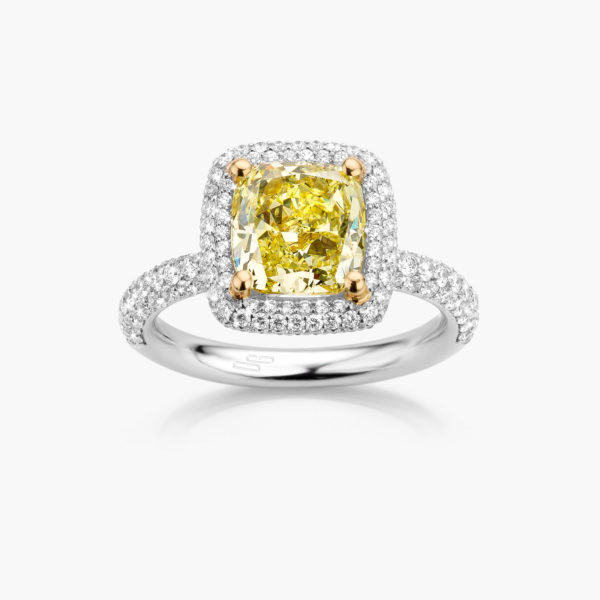 White gold ring ((Fancy Yellow)) set with a cushion shaped yellow diamond and brilliants