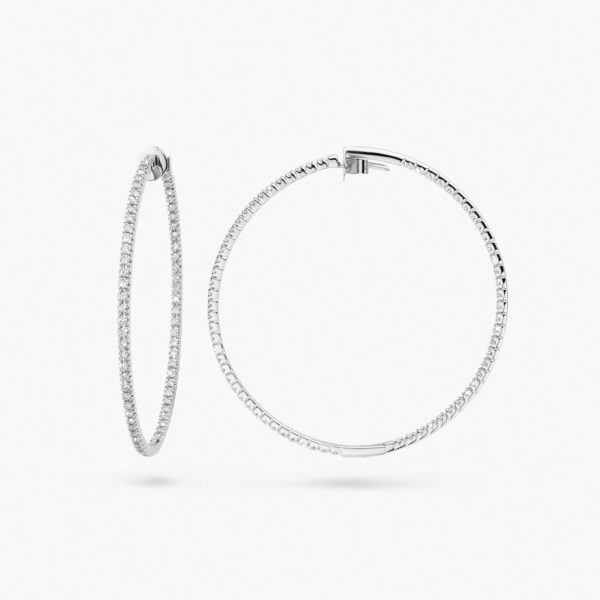 White gold earrings ((Linea Pura)) set with brilliants