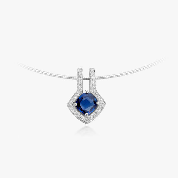White gold pendant set with blue sapphire and brilliants
