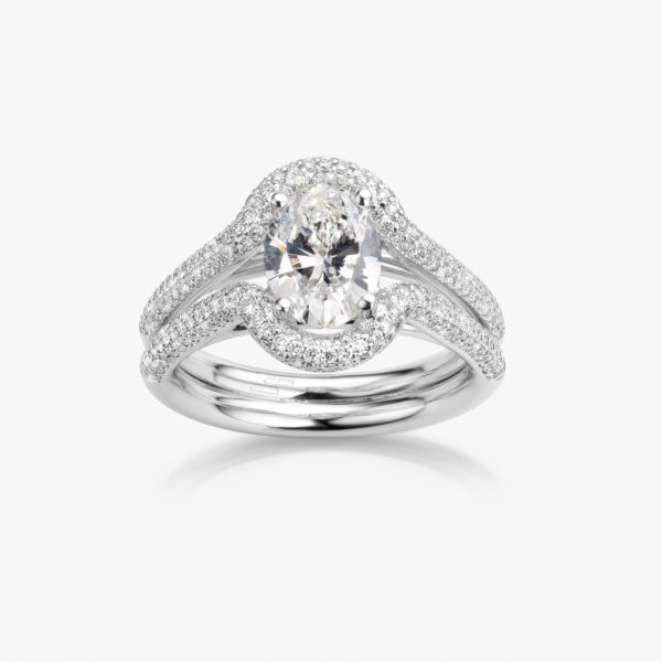 White gold ring set with oval shaped diamond and brilliants
