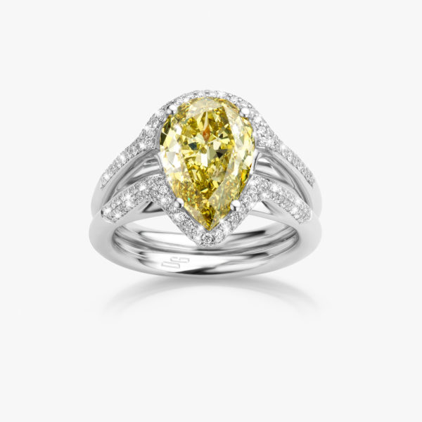 White gold ring set with pear shaped diamond ((Fancy Yellow)) and brilliants