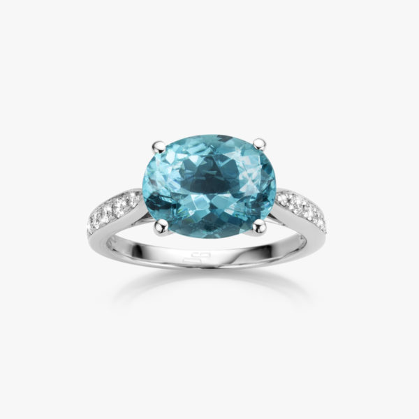 White gold ring set with oval shaped blue green tourmaline and brilliants