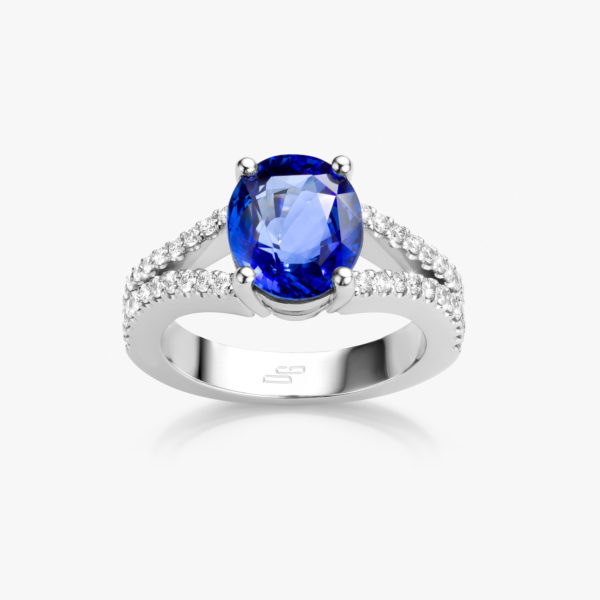 White gold ring set with oval shaped blue saphire and brilliants
