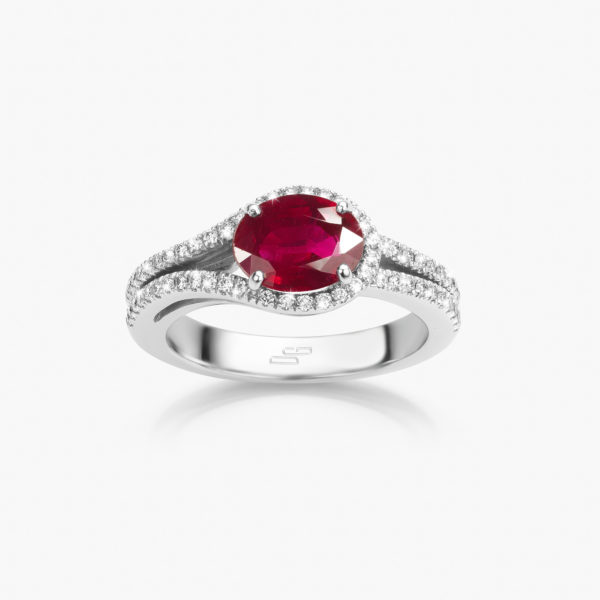 White gold ring set with an oval shaped ruby and brilliant cut diamonds