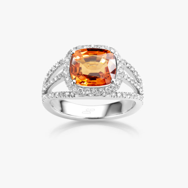 White gold ring set with orange sapphire and brilliants