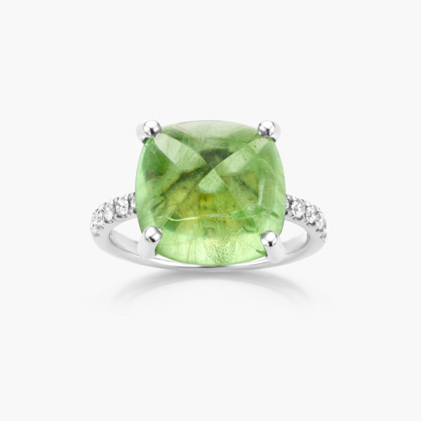 White gold ring set with a green peridot and brilliants